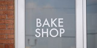 Bake Shop. A bake shop is a food bakery that prepares all types of pastries and baked goods such as cookies, pies, cakes, muffins, donuts and apple turnovers stock photo
