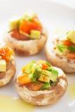 Baked充塞了与菜的蘑菇 免版税库存图片