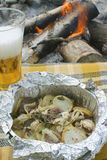 Baked. In foil. Beer and potatoes Stock Images
