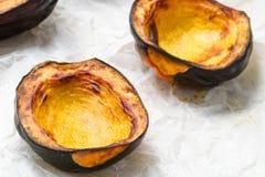Baked acorn squash. Oven roasted acorn squash, AKA cheastnut squash Stock Images