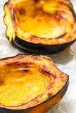 Baked acorn squash. Oven roasted acorn squash, AKA cheastnut squash Royalty Free Stock Photo