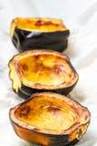 Baked acorn squash. Oven roasted acorn squash, AKA cheastnut squash Royalty Free Stock Photos