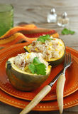 Baked acorn squash with rice and chicken stuffing Royalty Free Stock Photos