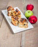 Baked apple bread pudding on white plate Stock Photos