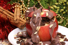 Baked apple with chocolate pudding Stock Photos