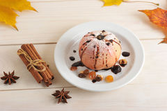 Baked Apple with cinnamon and autumn leaves Royalty Free Stock Photo