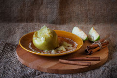 Baked apple with cinnamon on plate, soft focus Stock Images