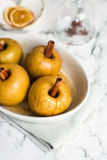 Baked apple with cinnamon stick Stock Photography