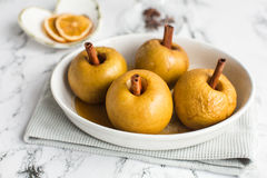 Baked apple with cinnamon stick Royalty Free Stock Photos