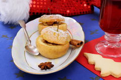 Baked apple with cookies and mulled wine Stock Photography