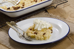 Baked apple crumble with raisins and cream Stock Photos