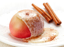 Baked apple dessert with vanilla sauce Stock Image