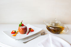 Baked apple with jam and herbal tea Royalty Free Stock Images