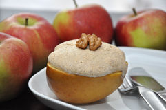 Baked Apple with Meringue. Walnut Topping Royalty Free Stock Photos