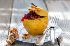 Baked apple with nuts and cowberry. Royalty Free Stock Photography