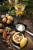 Baked apple with nuts, honey and oat flakes Royalty Free Stock Photos