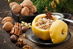 Baked apple with nuts, honey and oat flakes Stock Photography
