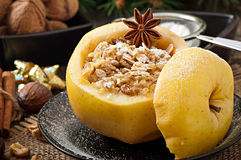 Baked apple with nuts, honey and oat flakes Stock Image