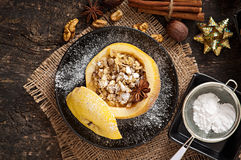 Baked apple with nuts, honey and oat flakes Royalty Free Stock Image