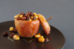 Baked apple with nuts and raisins Stock Photography