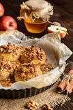 Baked apple with oatmeal, walnuts, honey and cinnamon Stock Photography