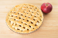 Baked apple pie. Against wooden background Royalty Free Stock Photography