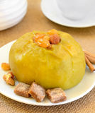 Baked apple with raisins Stock Image