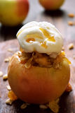 Baked apple served with ice cream Royalty Free Stock Images