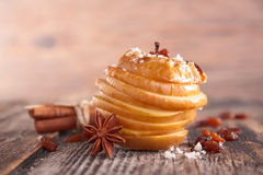 Baked apple with spice. On wood Royalty Free Stock Photography