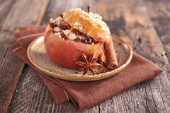 Baked apple with spices. On wood Stock Images