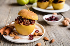 Baked apple stuffed with nuts, dried fruit and honey Stock Image
