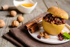 Baked apple stuffed with nuts, dried fruit and honey Royalty Free Stock Photo