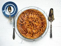 Apple tart. Baked apple tart on a rack to cool before being sliced royalty free stock photography
