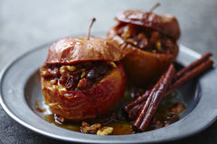 Baked apple. With walnuts,brown sugar, cinnamon,and raisins stock images