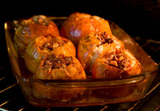 Baked apples. Filled with honey and walnuts inside the oven Royalty Free Stock Photography