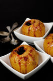 Baked apples. Stuffed with berries and orange Stock Photos