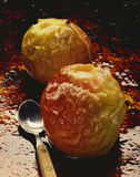 Baked apples. Two baked apples on caramel sauce Stock Photos