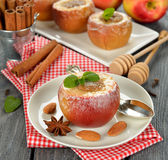 Baked apples. With almond stuffing, on a white plate Stock Photo