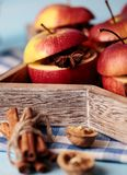 Baked apples with cinnamon on rustic background. Autumn or winter dessert. Closeup photo of a tasty baked apples with christmas de Royalty Free Stock Image