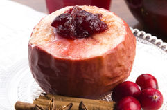 Baked apples with cranberry jam Stock Images