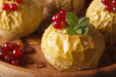 Baked apples decorated with red currants and mint macro horizont Royalty Free Stock Images