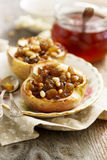 Baked apples. With fruit and nuts Royalty Free Stock Photos