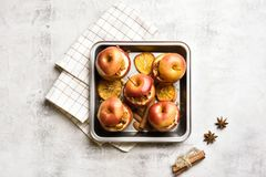 Baked apples with granola, cinnamon, nuts royalty free stock image