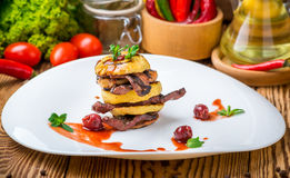 Baked apples and grilled meat Royalty Free Stock Image