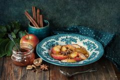Baked apples with honey. Flavored with anise, cinnamon and nuts Stock Photography