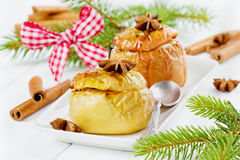 Baked apples with honey, curds, raisins and nuts i Stock Photos