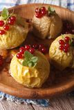 Baked apples with honey decorated red currants close up vertical Stock Photos