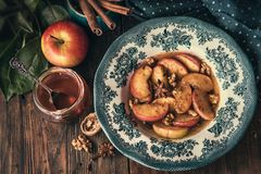 Baked apples with honey. Flavored with anise, cinnamon and nuts royalty free stock images