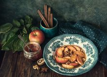 Baked apples with honey. Flavored with anise, nuts, cinnamon and nuts royalty free stock photos