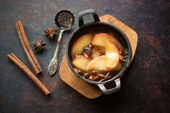 Baked apples with honey. Flavored with anise, nuts and cinnamon stock photos